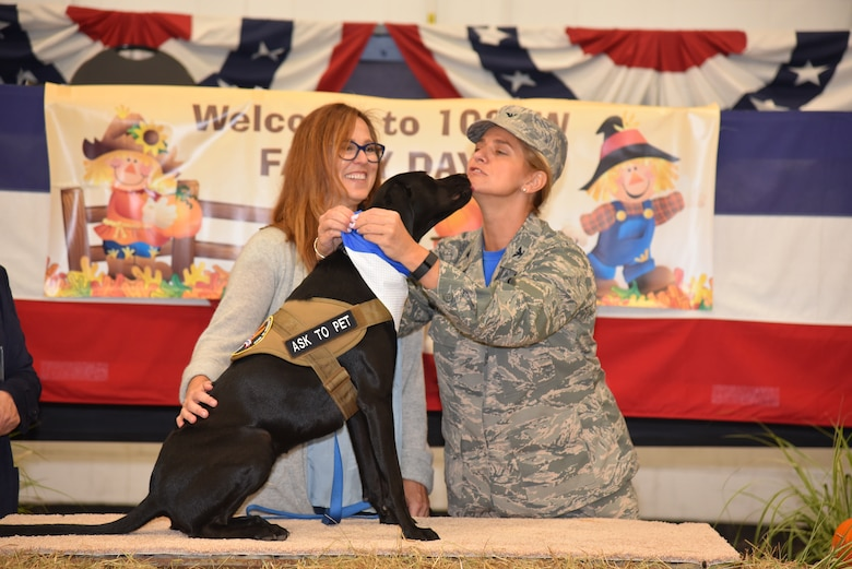 The 102nd Intelligence Wing celebrates their annual Family Day event at Otis Air National Guard base on Oct. 2, 2016. During the annual event there were various awards presented, along with multiple Community College of the Air Force degrees, and Zoe the therapy dog was enlisted as the newest member of the unit.(National Guard Photo by Tech. Sgt. Lindsey Sarah Watson-Kirwin/Released)