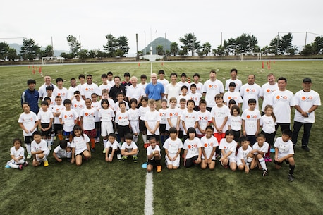 Marine Corps Air Station Iwakuni residents and Japanese locals pose for a group photo during the U.S.-Japan Children Soccer event at the Suo-Oshima Athletic Field in Suo-Oshima, Japan, Oct. 1, 2016. As part of a good keeping with the U.S.-Japan relationship, soccer was used to break the barrier of communication through words and teach children communication through actions. (U.S. Marine Corps photo by Lance Cpl. Joseph Abrego)