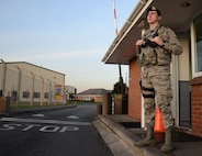 U.S. Air Force Airman 1st Class Jacob Yarbrough, 100th Security Forces Squadron response force member, keeps watch at the gate Sept. 23, 2016, on RAF Mildenhall, England. Yarbrough and 100th SFS Airmen keep the base secure by defending the gates day and night. (U.S. Air Force photo by Gina Randall)