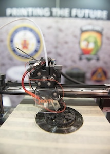 160928-N-IL267-005 QUANTICO, Virginia (Sept. 28, 2016) A 3-D printer additively manufactures a symbol at Modern Day Marine Expo at Marine Corps Base Quantico, Va. The symbol represents Naval Sea Systems Command, Naval Aviation Systems Command, Marine Corps Systems Command, the Marine Corps Warfighting Laboratory, and Marine Corps Headquarters, Installations and Logistics Department, all of which collaborated on an additive manufacturing parts demonstration at the expo. (U.S. Navy photo by Dustin Q. Diaz/released)