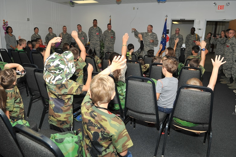 U.S. Air Force Col. Michael Downs, 17th Training Wing Commander, questions children before they go on a mock deployment during Operation Kids Investigating Deployment Services at the Vance Deployment Center, Goodfellow Air Force Base, Texas, Oct. 1, 2016. Operation KIDS is an annual event designed to introduce military children to deployment operations that their parents may experience. (U.S. Air Force photo by Staff Sgt. Laura R. McFarlane/Released)