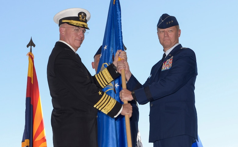 Adm. Kurt Tidd, commander of U.S. Southern Command, passes the Twelfth Air Force (Air Forces Southern) flag to Lt. Gen. Mark Kelly, commander of Twelfth Air Force (Air Forces Southern), during the a change of command ceremony Oct. 3, 2016, at Davis-Monthan Air Force Base, Ariz. During the ceremony Lt. Gen. Chris Nowland relinquished command to Lt. Gen. Mark Kelly. Air Forces Southern serves as the air component to U.S. Southern Command and is responsible for providing air and space capabilities in support of U.S. military partnerships across Central and South America, and the Caribbean. (U.S. Air Force photo by Tech. Sgt. Heather Redman)