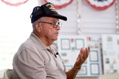 Retired Army Master Sgt. Santos Rodriguez, a veteran of the Korean and Vietnam wars, speaks about his military experience during an interview in Cabo Rojo, Puerto Rico, Aug. 10, 2016. DoD photo by EJ Hersom