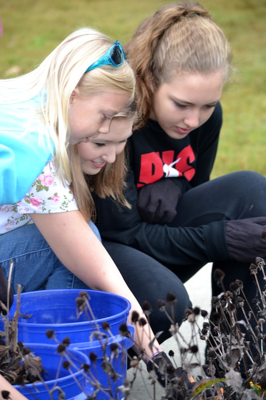 These young girls remove dead plants from a garden bed at the Cheatham Lake Resource Manager's Office during a National Public Lands Day event Oct. 1, 2016. Cheatham County Master Gardeners orchestrated planting bee-and-butterfly-friendly plants.