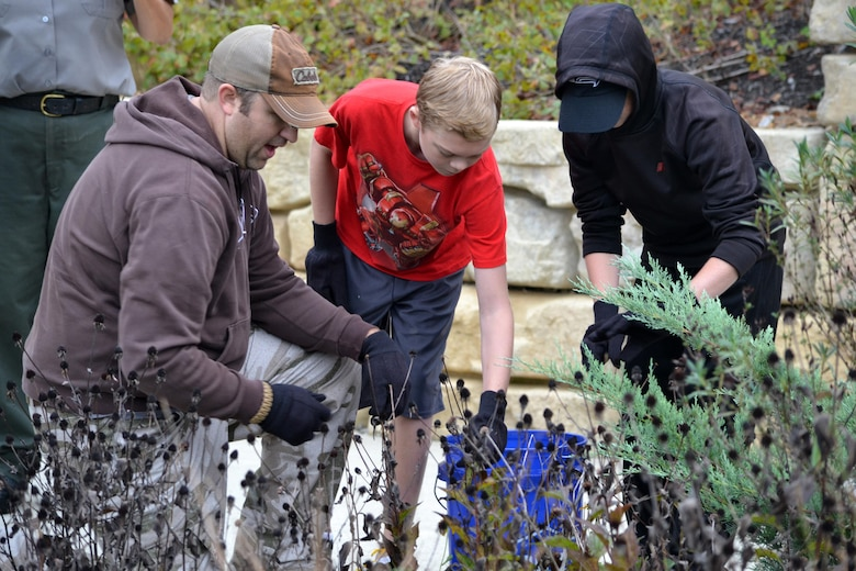 Volunteers remove dead plants from a garden bed at the Cheatham Lake Resource Manager's Office during a National Public Lands Day event Oct. 1, 2016. Cheatham County Master Gardeners orchestrated planting bee-and-butterfly-friendly plants.
