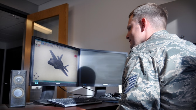 Tech. Sgt. Jake Lewis, 419th Maintenance Squadron, analyzes an F-35 assigned to Hill AFB in a 3D program that determines what measures need to be taken to keep the jet stealthy. Lewis is a low observable journeyman for the F-35 Lightning II. (U.S. Air Force photo/Bryan Magaña)