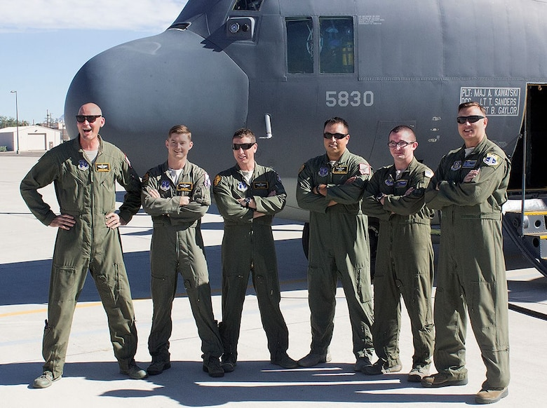The last active-duty aircrew for the HC-130 P/N King poses for a photo at Kirtland before taking off to bring the plane to Patrick Air Reserve Base, Florida. Crew members are, from left, Maj. Christian Walley, Maj. Sean Bell, Lt. Col. Kit Flanders, Master Sgt. Bobby Martinez, Staff Sgt. Kyle McQuiston and Master Sgt. George Telesh. The King was the last in the active-duty Air Force. Only Reserve and Air National Guard units will use the planes now. (Photo by Bud Cordova)