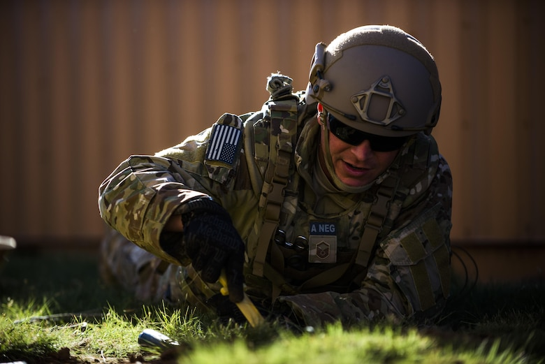Master Sgt. Jeremy Phillips, 27th Special Operations Civil Engineer Squadron Explosive Ordnance Disposal flight chief, searches for simulated improvised explosive devices during IED training at Melrose Air Force Range, N.M., Sept. 28, 2016. Phillips, along with other experienced EOD members, performed and demonstrated different techniques and ways of thinking for the younger members. (U.S. Air Force photo by Senior Airman Luke Kitterman/Released)