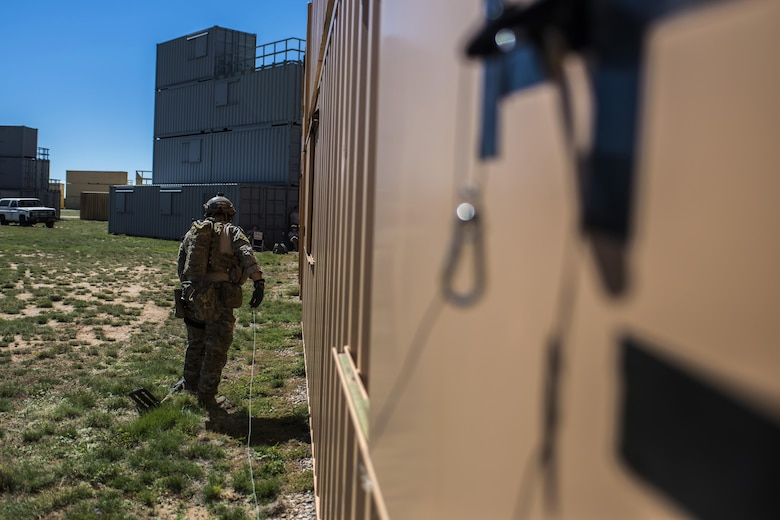 A member of the 27th Special Operations Civil Engineer Squadron Explosive Ordnance Disposal flight uses his equipment to open a window during improvised explosive device training at Melrose Air Force Range, N.M., Sept. 28, 2016. The flight conducted more than five different scenarios which they could possibly encounter in a deployed environment. (U.S. Air Force photo by Senior Airman Luke Kitterman/Released)