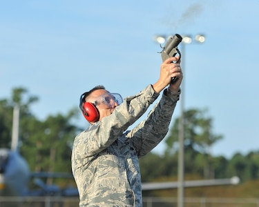 U.S. Air Force Chief Master Sgt. Todd Petzel, 18th Air Force command chief, fires a flare gun Sept. 28, 2016, at Joint Base Charleston, South Carolina during his visit to the 437th Operations Support Squadron. Members of the base's Bird/Animal Aircraft Strike Hazard program uses flare guns to frighten birds away from the flight line. Bird strikes can cause millions of dollars in fuselage and engine damage and even the total loss of an aircraft.
