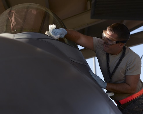 U.S. Air Force Senior Airman Jared Carnahan, 44th Fighter Group crew chief, cleans the windshield of an F-22 Raptor on the flightline at Tyndall Air Force Base, Fla., Sept. 10, 2016. In addition to maintaining and repairing the F-22, crew chiefs at Tyndall also ensure the jet is in perfect condition before the pilot enters the jet. The 44th FG accomplishes total force integration by providing pilots, maintainers and support personnel in partnership with the 325th Fighter Wing to execute the Tyndall mission to train and project unrivaled combat air power. (U.S. Air Force photo by Airman 1st Class Cody R. Miller/Released)
