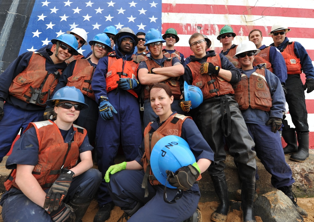 BALTIMORE – Crewmembers from the Coast Guard Cutter Sledge and James Rankin, both based out of Baltimore, pose for a group picture during their Earth Day project to clean up the shore in Curtis Bay, Md., April 21, 2011. The two ships sent volunteers from each crew to assist in the clean up efforts to improve the environment. U.S. Coast Guard photos by Petty Officer 3rd Class Robert Brazzell.