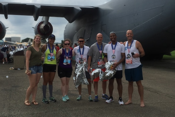 Members of Keesler's Dragon Run Club pose for a photo with other participants following completion of the 20th annual Air Force Marathon, SEpt. 17, 2016, on Wright-Patterson Air Force Base, Ohio. Eight members of Team Keesler participated in the 26.2 mile run. (Courtesy photo)