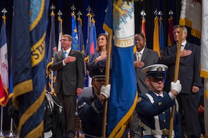 Defense Secretary Ash Carter shows respect during the opening presentation for the Department of Defense Disability Awards ceremony at the Pentagon, Oct. 4, 2016. DoD photo by Air Force Tech. Sgt. Brigitte N. Brantley