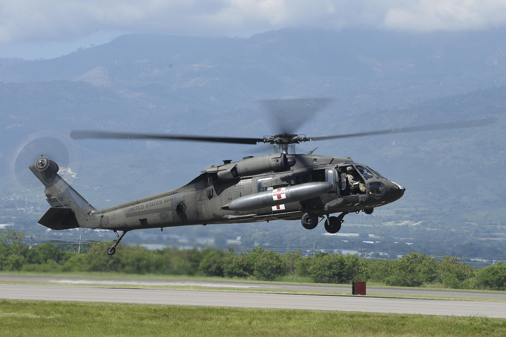 An HH-60L Black Hawk helicopter prepares to launch from Soto Cano Air Base, Honduras, Oct. 4, 2016, to stage at the Grand Cayman Islands to support Hurricane Matthew relief efforts if requested by the U.S. Agency for International Development's Office of Foreign Disaster Assistance. The Black Hawk is assigned to Joint Task Force-Bravo's 1st Battalion, 228th Aviation Regiment. Air Force photo by Staff Sgt. Siuta B. Ika