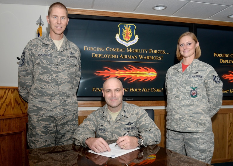 U.S. Air Force Col. Todd Hohn, 97th Air Mobility Wing commander, Chief Master Sgt. Philip Eckenrod, 97th AMW command chief, and Tech. Sgt. Jessica Packard, Altus AFB Fire Department deputy fire chief, attend the signing of the proclamation for National Disability Employment Awareness Month, Sept. 30, 2016, at Altus Air Force Base, Okla. The proclamation signifies the bases participation during NDEAM. (U.S. Air Force Photo by Airman Jackson N. Haddon/Released).
