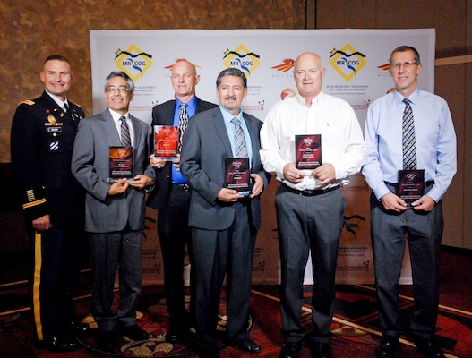 (l-r): Lt. Col. James Booth, Albuquerque District Commander and project managers Jerry Nieto, USACE; Brad Bingham, AMAFCA; Ray Gomez, MRGCD; Robert Kane, APS; and Brad Catanach, Bernalill County, accept the award, Sept. 9, 2016.
