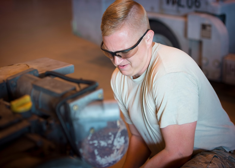Senior Airman Miles Shepperd, an aerospace ground equipment journeyman with the 1st Special Operations Maintenance Squadron, removes an exhaust pipe from a munitions handling unit at the AGE hangar on Hurlburt Field, Fla., Oct. 3, 2016. The MHU can carry over 6,500 pounds of ammunition. (U.S. Air Force photo by Senior Airman Krystal M. Garrett)