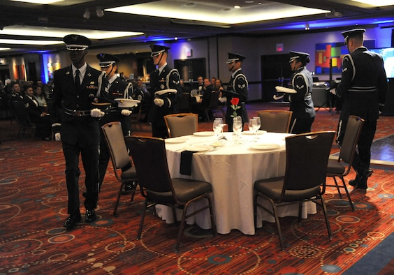 Members of the Keesler Air Force Base Honor Guard perform a POW/MIA table ceremony during the Keesler Air Force Ball at the Imperial Palace Casino Sept. 24, 2016, Biloxi, Miss. The event was sponsored by the Air Force Association John C. Stennis Chapter #332 to celebrate the Air Force's 69th birthday and the base's 75th anniversary. (U.S. Air Force photo by Kemberly Groue/Released)