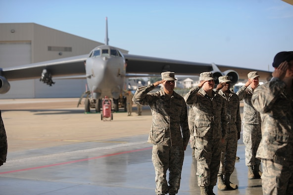 A B-52 Stratofortress sits in the background as Eighth Air Force Airmen salute their new commander during the change of command ceremony at Barksdale Air Force Base, La., Oct. 4 2016. U.S. Air Force Maj. Gen. Thomas Bussiere assumed command from Maj. Gen. Richard Clark, becoming the 53rd commander of The Mighty Eighth. (U.S. Air Force photo by Airman 1st Class Stuart Bright)