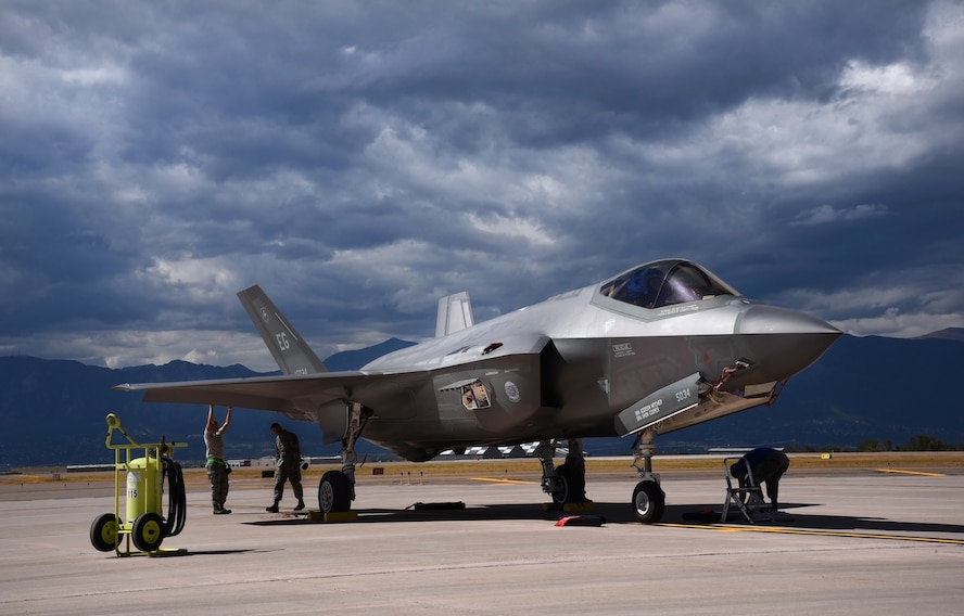 PETERSON AIR FORCE BASE, Colo. – Avionic technicians and crew chiefs perform a post-operation servicing to an F-35A Lightning II assigned to the 58th Fighter Squadron at Eglin Air Force Base, Fla., while on the flightline at Peterson AFB, Colo., Sept. 30, 2016. Four F-35s landed at Peterson AFB to execute a flyover during the U.S. Air Force Academy versus the U.S. Naval Academy football game at USAFA. (U.S. Air Force photo by Airman 1st Class Dennis Hoffman)