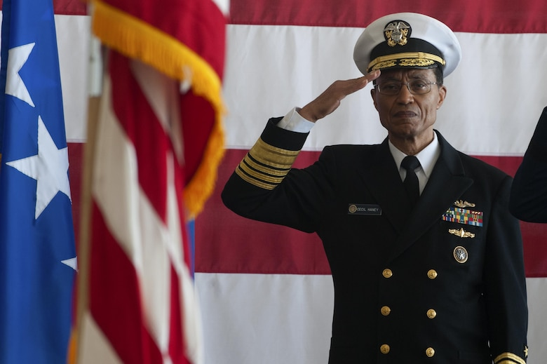 U.S. Navy Admiral Cecil Haney salutes an audience of bomber Airmen during the Joint Functional Component Command for Global Strike and Task Force 204 change of command ceremony at Barksdale Air Force Base, La., Oct. 4, 2016. The JFCC-GS and TF204 commander roles are duties held by the Eighth Air Force commander, who is responsible for all of the Air Force's bombers. U.S. Maj. Gen. Thomas Bussiere assumed command from Maj. Gen. Richard Clark. (U.S. Air Force photo by Senior Airman Joseph Raatz)