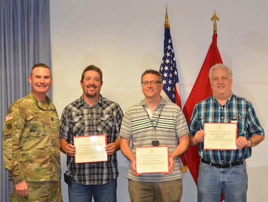 ALBUQUERQUE, N.M. – District Commander Lt. Col. James Booth recognized (l-r) Tim Tetrick, Mike Prudhomme, and David Abbott, Sept. 26, 2016, for their work in completing a cost estimate for the National Nuclear Security Administration Albuquerque Complex project located here.