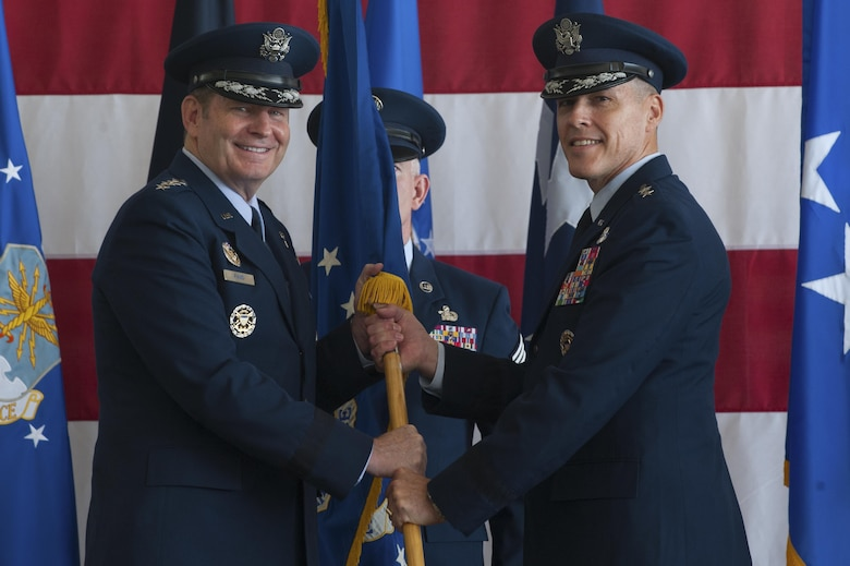 From left, U.S. Air Force Gen. Robin Rand, commander of Air Force Global Strike Command, passes the Eighth Air Force flag to Maj. Gen. Thomas Bussiere signifying the changing of command for The Mighty Eighth. Bussiere is the 53rd commander of the Eighth Air Force and responsible for all of the Service's bomber fleets. (U.S. Air Force photo by Senior Airman Joseph Raatz)