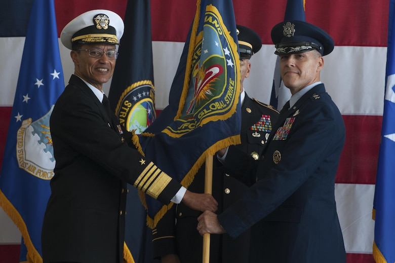 From left, U.S. Navy Admiral Cecil Haney, commander of U.S. Strategic Command, passes the Joint Functional Component Command for Global Strike flag to U.S. Air Force Maj. Gen. Thomas Bussiere, the new JFCC-GS commander during a change of command ceremony at Barksdale AFB, La., Oct. 4, 2016. Bussiere is also the Task Force 204 commander, who oversees the Air Force nuclear bomber and reconnaissance activities in support of USSTRATCOM. (U.S. Air Force photo by Senior Airman Joseph Raatz)