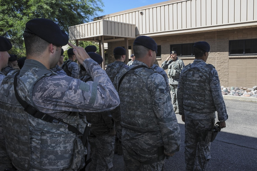 U.S. Airmen from the 355th Security Forces Squadron salute during a guard mount formation at Davis-Monthan Air Force Base, Ariz., Sept. 29, 2016. The 355th SFS mission is to protect, defend and fight to enable Air Force, joint and coalition mission success.  (U.S. Air Force photo by Airman 1st Class Mya M. Crosby)