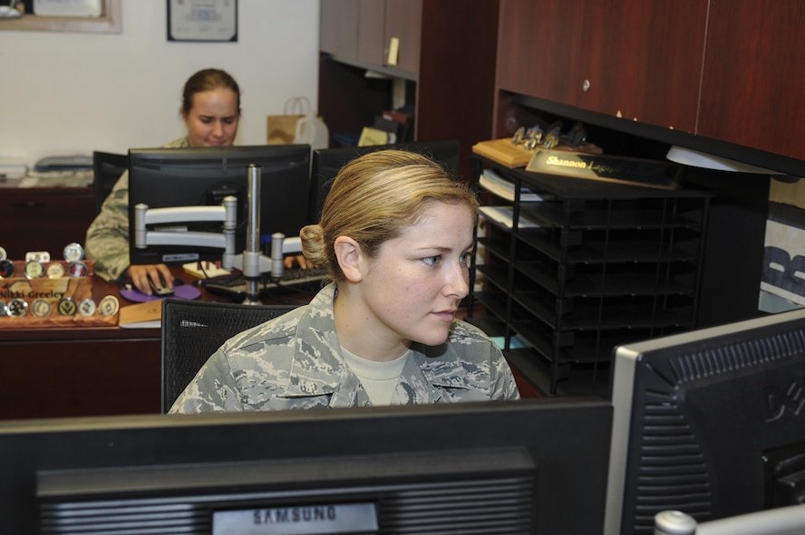 U.S. Air Force Senior Airman Shannon Lagapa-Talbott, 355th Security Forces Squadron commander support staff personnel, update records at Davis-Monthan Air Force Base, Ariz., Sept. 29, 2016. The 355th SFS consists of over 300 military and civilian personnel. (U.S. Air Force photo by Airman 1st Class Mya M. Crosby)