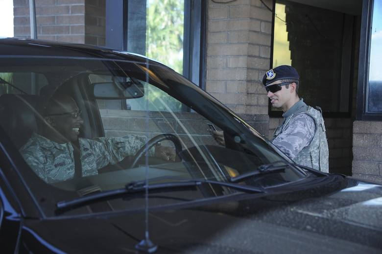 U.S. Air Force Senior Airman Phillip West, 355th Security Forces Squadron member, welcomes an Airman to Davis-Monthan Air Force Base, Ariz., Sept. 29, 2016. The 355th SFS mission is to protect, defend and fight to enable Air Force, joint and coalition mission success.  (U.S. Air Force photo by Airman 1st Class Mya M. Crosby)