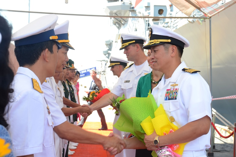 160928-N-WJ640-075 DA NANG, Vietnam (Sept. 29, 2016) Capt. H. B. Le, commodore, Destroyer Squadron 7, shakes hands with members of the Vietnam People's navy during a welcome ceremony in Da Nang, Vietnam Sept. 29 in support of Naval Engagement Activity (NEA) Vietnam 2016. In its seventh year, NEA Vietnam is designed to foster mutual understanding, build confidence in the maritime domain and strengthen relationships between the U.S. Navy, Vietnam People's navy and the local community. (U.S. Navy photo by Mass Communication Specialist 3rd Class Madailein Abbott)
