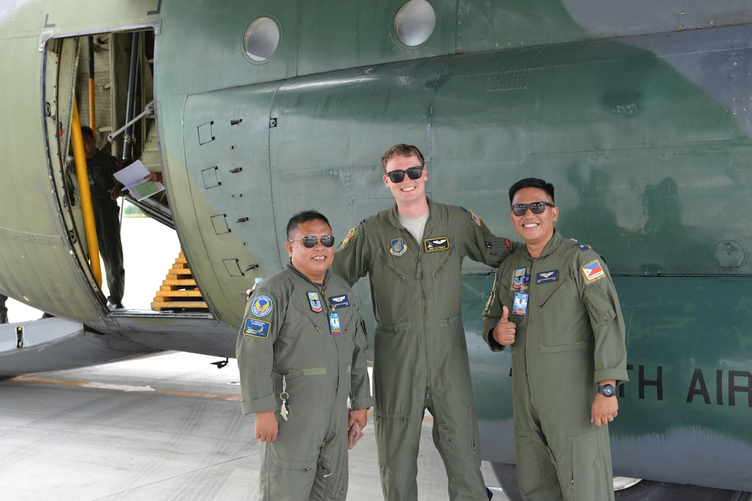U.S. Air Force Capt. Mike Dzyndra, mission navigator, 36th Airlift Squadron, 374 Airlift Wing, Yokota Air Base, Japan (middle), stands with two Philippine Air Force pilots prior to the trio's participation in a mass casualty response drill during the current iteration of a rotational Air Contingent at Brigadier General Benito N Ebuen Air Base, Philippines, Sept. 29, 2016. Two C-130 Hercules aircraft and crews from 374th Airlift Wing, Yokota Air Base, Japan, the 36th Contingency Response Group from Andersen Air Force Base, Guam, and other units from across U.S. Pacific Command conducted bilateral training missions and subject matter expert exchanges alongside their Philippine Air Force counterparts. (U.S. Air Force photo by Capt. Mark Lazane)