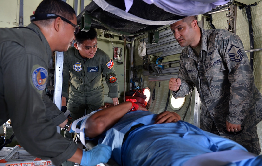 U.S. Air Force Master Sgt. Nick Wentworth, independent medical duty technician, assigned to the 342nd Training Squadron, Lackland Air Force Base, Texas, exchanges lessons learned with his Philippine Air Force counterparts in the midst of a mass casualty response capstone event during the current iteration of a rotational Air Contingent at Brigadier General Benito N Ebuen Air Base, Philippines, Sept. 29, 2016. During the mass casualty subject matter expert exchange, civilian and military disaster response experts from the two countries met together to exchange ideas and best practices. The Air Contingent is helping build the capacity of the Philippine Air Force and increases joint training, promotes interoperability and provides greater and more transparent air and maritime situational awareness to ensure safety for military and civilian activities in international waters and airspace. Its missions include air and maritime domain awareness, personnel recovery, combating piracy, and assuring access to the air and maritime domains in accordance with international law. (U.S. Air Force photo by Capt. Mark Lazane)