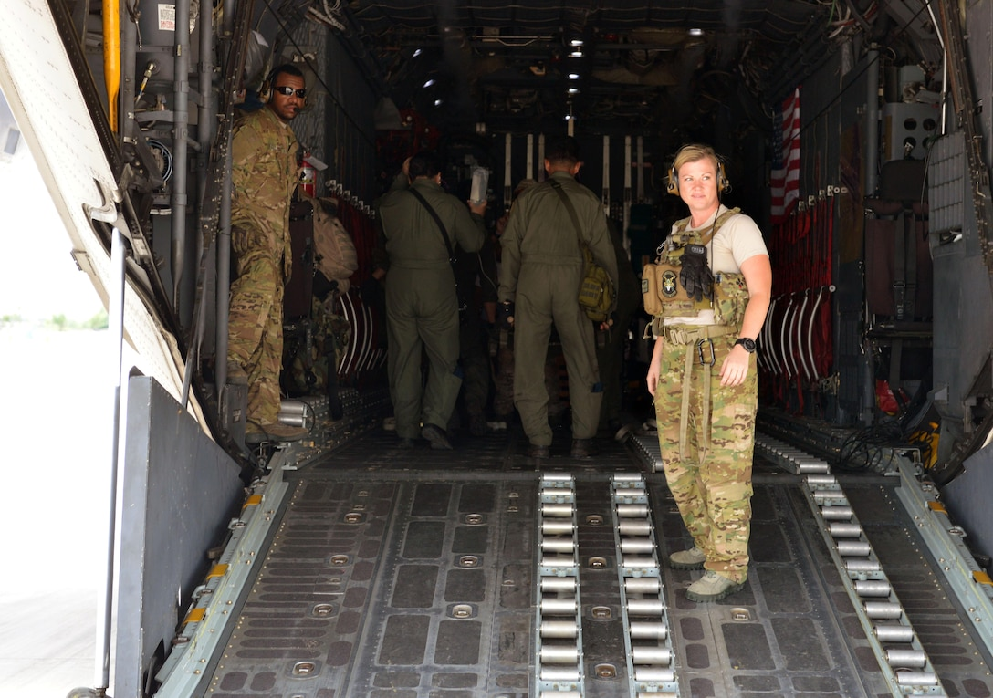 U.S. Air Force crew members from Kadena Air Base, Japan, await passengers during an engines running onload drill as part of a mass casualty response exercise during the current iteration of a rotational Air Contingent at Brigadier General Benito N Ebuen Air Base, Philippines, Sept. 29, 2016. Two C-130 Hercules aircraft and crews from 374th Airlift Wing, Yokota Air Base, Japan, the 36th Contingency Response Group from Andersen Air Force Base, Guam, and other units from across U.S. Pacific Command conducted bilateral training missions and subject matter expert exchanges alongside their Philippine Air Force counterparts.  (U.S. Air Force photo by Capt. Mark Lazane)