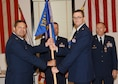 While outgoing commander Lt. Col. Lane Endicott stands by, Maj. Daniel Nelsen accepts the 131st Civil Engineers Squadron guidon from 131st Bomb Wing Mission Support Group commander Col. Mike Jurries. The change of command ceremony was held at Jefferson Barracks Air National Guard Base, Missouri, Oct 1, 2016. (U.S. Air National Guard photo by Senior Master Sgt. Mary-Dale Amison)