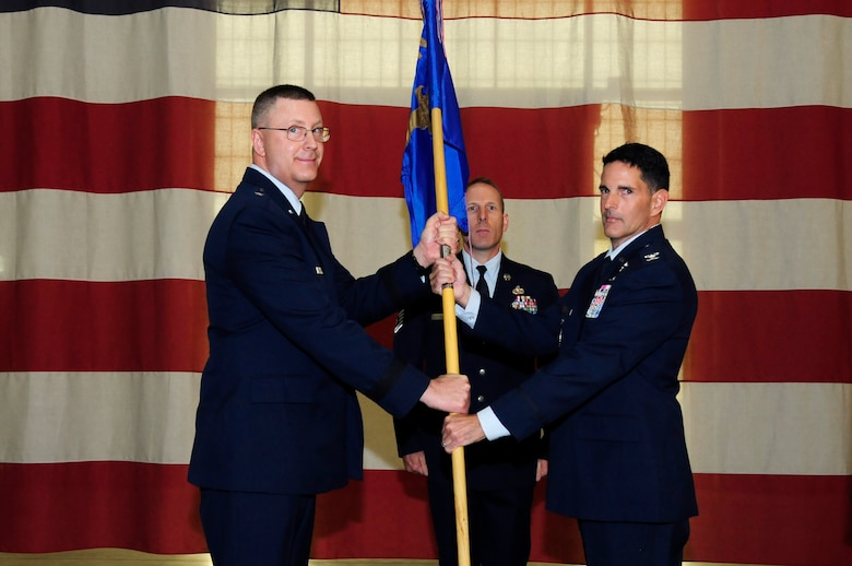 U.S. Air Force Col. Michael Troy Gerock (right) accepts command of the 145th Airlift Wing from Brig. Gen. Roger E. Williams Jr. (left), Assistant Adjutant General for Air, North Carolina Air National Guard (NCANG), during a change of command ceremony held at the NCANG Base, Charlotte Douglas International Airport, Oct. 1, 2016. Gerock is a C-130 Hercules aircraft pilot and has been a member of the NCANG for 23 years. (U.S. Air National Guard photo by Staff. Sgt. Julianne M. Showalter)