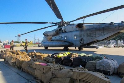 Marines deployed to Honduras prepare a CH-53E Super Stallion to deploy to Grand Cayman Island, Oct. 4, 2016. U.S. Southern Command directed a team of about 100 military personnel and nine helicopters to Grand Cayman Island where they will be staged and ready to support U.S. disaster relief operations in the Caribbean if requested by U.S. Agency for International Development. Marine Corps photo
