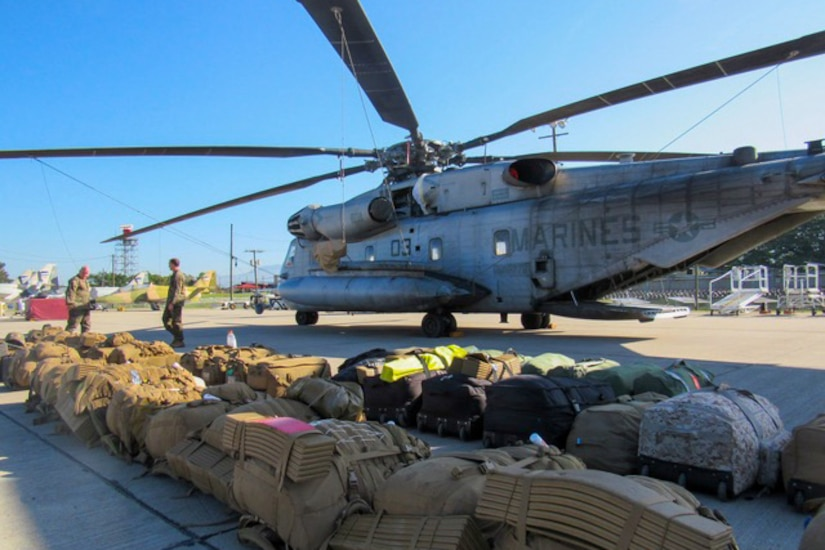 Marines deployed to Honduras prepare a CH-53E Super Stallion helicopter to deploy to Grand Cayman Island, Oct. 4, 2016. U.S. Southern Command directed a team of about 100 military personnel and nine helicopters to Grand Cayman Island where they will be staged and ready to support U.S. disaster relief operations in the Caribbean if requested by U.S. Agency for International Development. Marine Corps photo