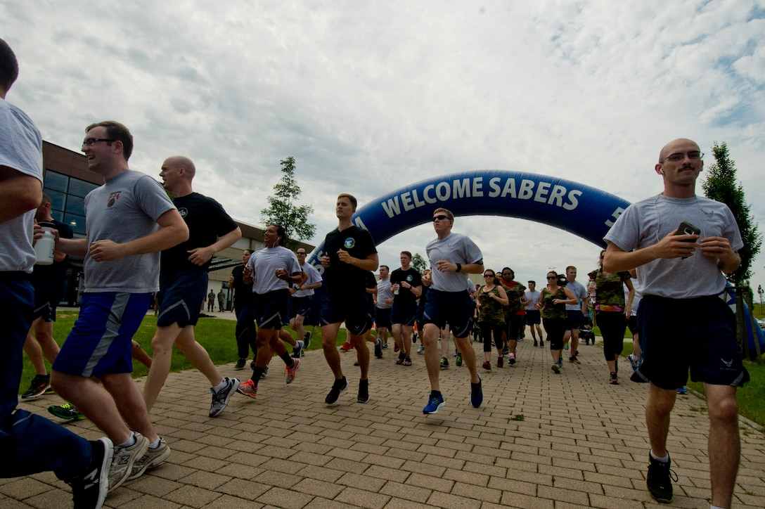 "Spangdahlem Air Base Airmen run in a 5K during the ""Are You the Best You Can Be?"" resiliency day event at the Eifel Powerhaus fitness center at Spangdahlem Air Base, Germany, June 24, 2016. The 52nd Aerospace Medicine Squadron's Health Promotions flight will be sponsoring a ""Triple-Ribbon"" 5K in honor of Breast Cancer Awareness Month, Domestic Violence Awareness Month and Prescription Drug Misuse Awareness Month outside the fitness center Oct. 7, 2016.  (U.S. Air Force photo by Staff Sgt. Joe W. McFadden/Released)"