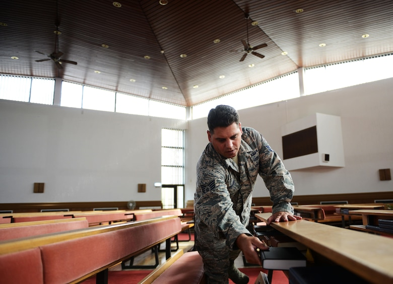 Staff Sgt. Johannes Cilliers, 86th Airlift Wing chaplain assistant, sets up a chapel for a religious service at Ramstein Air Base, Germany, Sept. 30, 2016. The Ramstein chapel community provides religious and counseling services to all Airmen, whether they are religious or not. (U.S. Air Force photo/ Airman 1st Class Joshua Magbanua)