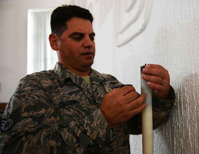 Staff Sgt. Johannes Cilliers, 86th Airlift Wing chaplain assistant, checks the oil in a candle for a Catholic mass at Ramstein Air Base, Germany, Sept. 30, 2016. Religious support teams, consisting of one chaplain and one chaplain assistant, aim to support the spiritual lives of all Airmen regardless of their religious beliefs. (U.S. Air Force photo/ Airman 1st Class Joshua Magbanua)