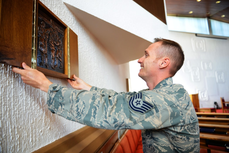 Technical. Sgt. Jere Ross, 86th Airlift Wing chaplain corps NCO in charge of plans and programs, sets up the Ramstein North Chapel for a religious service at Ramstein Air Base, Germany, Sept. 21, 2016. The Ramstein chapel community serves the spiritual needs of Airmen regardless of religion or spiritual beliefs. (U.S. Air Force photo/ Airman 1st Class Joshua Magbanua)