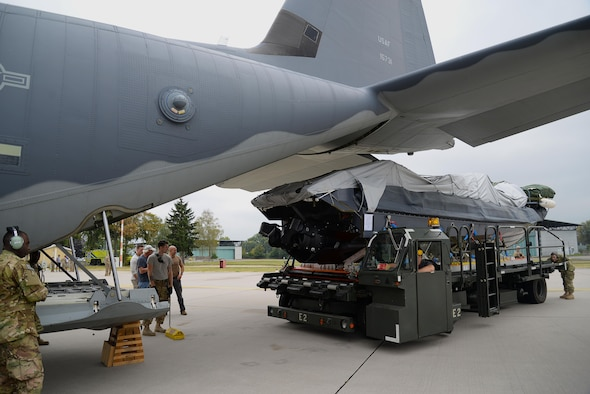 Loadmasters and crew chiefs from the 67th Special Operations Squadron guide a Rigid Inflatable Boat as it's loaded onto an MC-130J Commando II in preparation for a Maritime Craft Aerial Delivery drop Sept. 26, 2016, at Stuttgart Air Base, Germany. Two of three MC-130J Commando IIs from the 67th SOS were loaded for MCADS drops in participation with the 2016 Night Hawk exercise. (U.S. Air Force photo by Senior Airman Justine Rho)