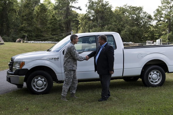 U.S. Air Force Col. Thomas Kunkel, 23d Wing commander, shakes hands with Bill Slaughter, Lowndes County Commission chairman, during a ceremony, Oct. 3, 2016, in Valdosta, Ga. Kunkel and Slaughter are members of the Moody Community Partnership Committee, which creates mutually beneficial partnerships between the base, local and city governments to improve cost efficiencies. (U.S. Air Force photo by  Airman 1st Class Janiqua P. Robinson)