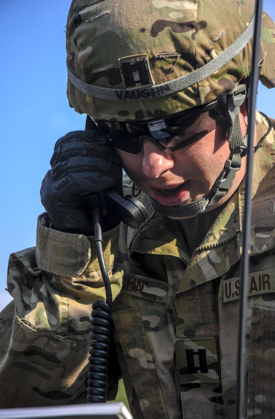 U.S. Air Force Capt. Scott Vaughn, 7th Weather Squadron current operations chief, calls in a medical evacuation helicopter during exercise Cadre Focus 16.2 in Grafenwoehr, Germany, Sept. 27, 2016. Calling in a medical evacuation was just one of the skills 7th WS Airmen practiced alongside their German and Polish counterparts during Cadre Focus 16.2. (U.S. Air Force photo by Staff Sgt. Timothy Moore)