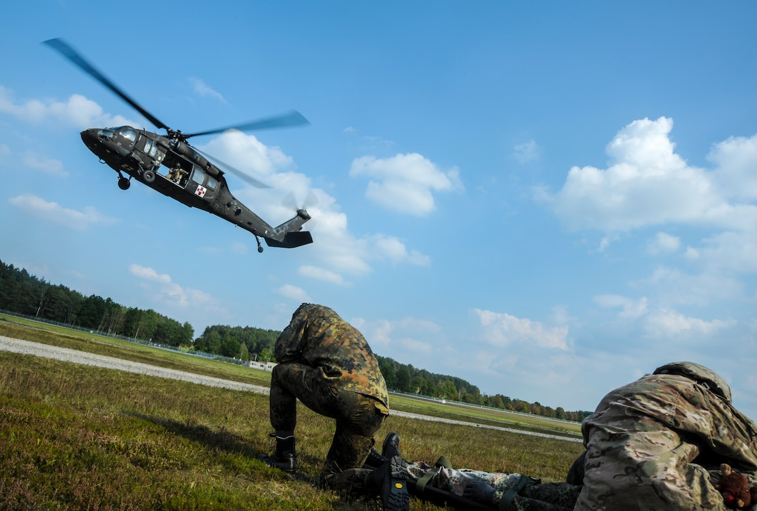 A U.S. Army UH-60 Black Hawk lands to pick up a medical evacuation request during exercise Cadre Focus 16.2 in Grafenwoehr, Germany, Sept. 27, 2016. Cadre Focus is a biannual training event, at which 7th Weather Squadron and 7th Expeditionary Weather Squadron Airmen refresh their familiarization with basic Army skills. Cadre Focus 16.2 marked the first time the weather forecasters invited their NATO allies' counterparts to practice these skills with them. (U.S. Air Force photo by Staff Sgt. Timothy Moore)