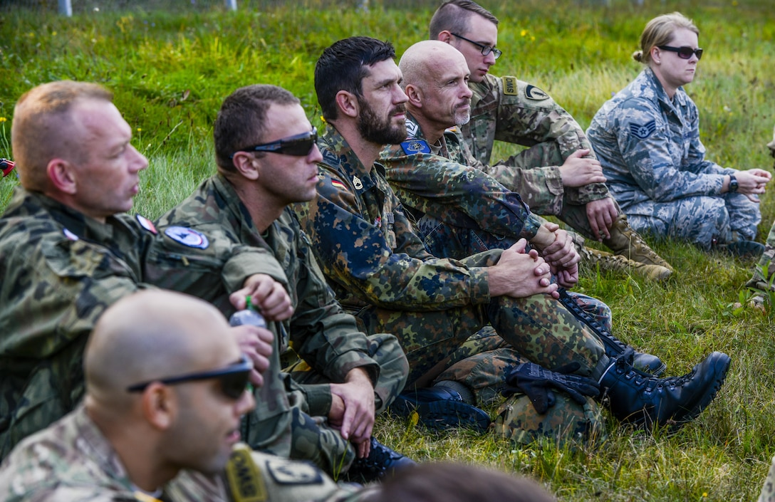 U.S., Polish and German service members wait to discuss the good and bad of the day's training in Grafenwoehr, Germany, Sept. 27, 2016. Service members from three NATO partners came together to train on basic U.S. Army skills during exercise Cadre Focus 16.2. Cadre Focus is a biannual training event for Airmen from the 7th Weather Squadron and 7th Expeditionary Weather Squadron. Cadre Focus 16.2 marked the first time the weather Airmen invited their NATO partners to the training event. (U.S. Air Force photo by Staff Sgt. Timothy Moore)