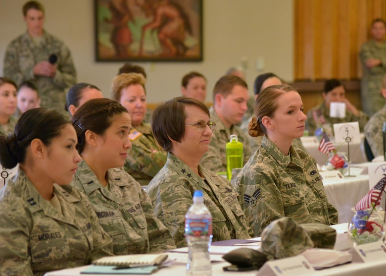 Maj. Gen. Sandra Finan, Deputy Chief Information Officer for Command, Control, Communications and Computers and Information Infrastructure Capabilities, Office of the Secretary of Defense, listens to a brief along with Airmen at the 20th Air Force Women's Leadership Symposium at Kirtland Air Force Base, N.M., Sept. 27, 2016. During her brief, Finan stressed the importance of Airmen executing the ICBM mission to continue doing so with professionalism, skill, dedication and expertise. The three-day event supports 20th AF's goal to coach, train and mentor nuclear professionals and leaders, while developing a nuclear command environment that fosters understanding, respect and the support necessary for people to thrive. (U.S. Air Force photo by Jamie Burnett)